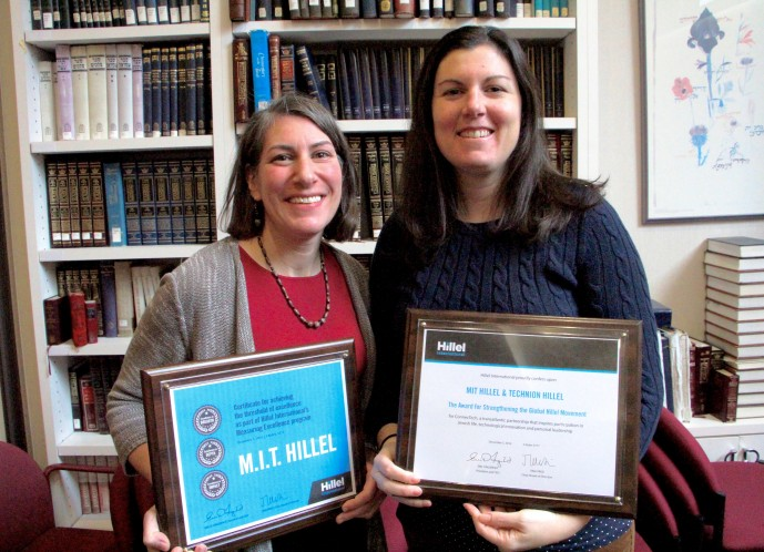Rabbi Michelle Fisher and Assistant Director Freed stand with their awards.