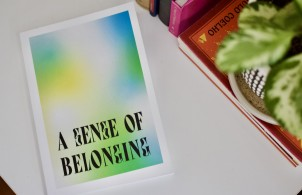 Green, yellow, blue tie-dye book cover titled A Sense of Belonging. Green-leafy plant in right corner.