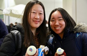 Students pictured with cupcakes