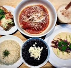 Six plates of mediterranean food