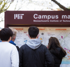 People looking at campus map