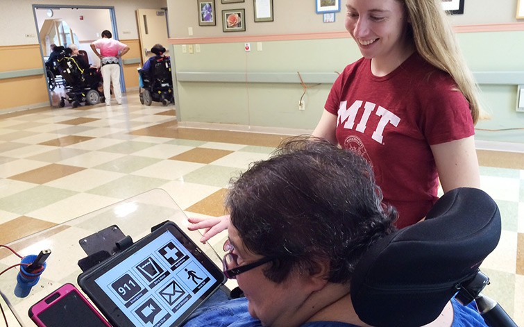 EAP grant recipient Beth Hadley '15 looks on as Margaret Marie uses the iPad application they co-designed